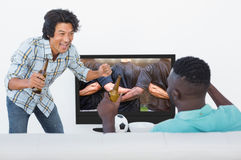 Composite image of soccer fans watching tv Royalty Free Stock Images