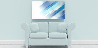 Composite image of sofa and blank picture frame in home. Sofa and blank picture frame in home against coloured lines Royalty Free Stock Photo