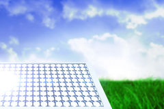 Composite image of solar equipment in hexagon shaped. Solar equipment in hexagon shaped against field of grass under blue sky Royalty Free Stock Photos