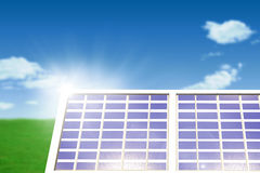 Composite image of solar panel equipment against white screen. Solar panel equipment against white screen against blue sky over green field Royalty Free Stock Photos
