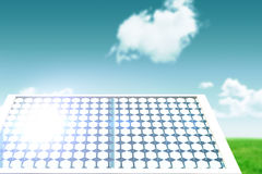 Composite image of solar panel with hexagon shape glasses. Solar panel with hexagon shape glasses against blue sky over green field Stock Photography