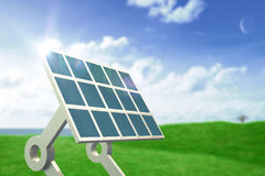 Composite image of solar panel with stand. Solar panel with stand against green field under blue sky Royalty Free Stock Photos