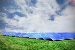 Composite image of solar panels. Solar panels against green field under blue sky stock illustration