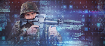 Composite image of soldier aiming with rifle. Soldier aiming with rifle against black angular design royalty free stock photos