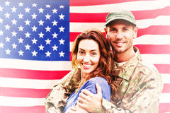 Composite image of soldier reunited with partner Royalty Free Stock Photography