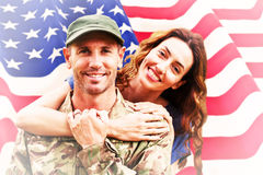Composite image of soldier reunited with partner Royalty Free Stock Photos