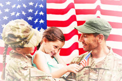 Composite image of soldiers reunited with daughter Stock Photo