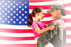Composite image of solider reunited with daughter Stock Photo