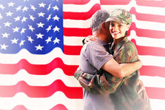Composite image of solider reunited with father Royalty Free Stock Photography