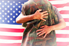Composite image of solider reunited with father Royalty Free Stock Photo