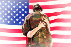 Composite image of solider reunited with mother Royalty Free Stock Photos