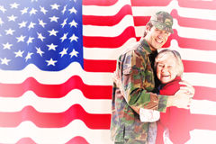 Composite image of solider reunited with mother Royalty Free Stock Image