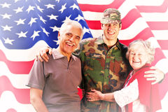 Composite image of solider reunited with parents Royalty Free Stock Photo