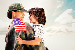 Composite image of solider reunited with son. Solider reunited with son against blue sky royalty free stock images