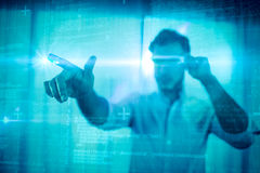 Composite image of some blue matrix and codes. Some Blue matrix and codes against businessman using an oculus Stock Images