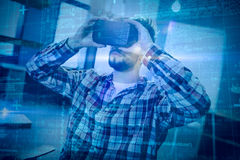Composite image of some blue matrix and codes. Some Blue matrix and codes against man using virtual reality headset Stock Photos