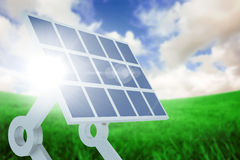 Composite image of sources of renewable energy equipment. Sources of renewable energy equipment against green field under blue sky Royalty Free Stock Photography