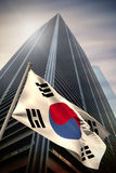 Composite image of south korea national flag. South korea national flag against low angle view of skyscraper royalty free stock images