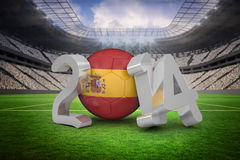 Composite image of spain world cup 2014. Spain world cup 2014 against vast football stadium with fans in white Royalty Free Stock Photo