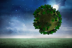 Composite image of sphere covered with forest Stock Photo