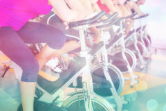 Composite image of spin class working out in a row Royalty Free Stock Photo