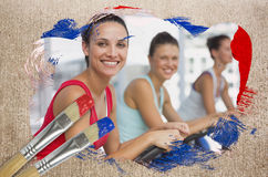 Composite image of spinning class in the gym Stock Photos