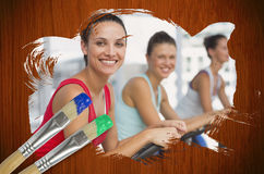 Composite image of spinning class in the gym Stock Image