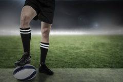 Composite image of sports player in black socks on ball Stock Photos