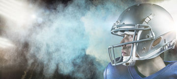 Composite image of sportsman with helmet looking away Royalty Free Stock Photos