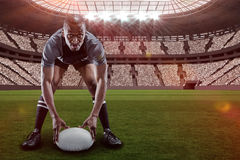 Composite image of sportsman holding ball while playing rugby with 3d. Sportsman holding ball while playing rugby against rugby stadium with copy space 3d stock image