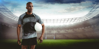 Composite image of sportsman with rugby ball Royalty Free Stock Photos