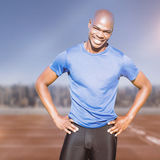 Composite image of sportsman smiling and posing on a white background Stock Images
