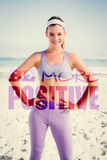 A Composite image of sporty blonde on the beach smiling at camera Stock Photo
