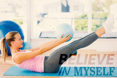 A Composite image of sporty young woman stretching body in fitness studio Royalty Free Stock Image