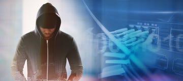 Composite image of spy in black hoodie. Spy in black hoodie against composite image of binary code on digital screen Royalty Free Stock Image