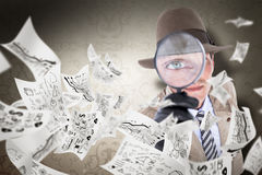 Composite image of spy looking through magnifier Royalty Free Stock Images