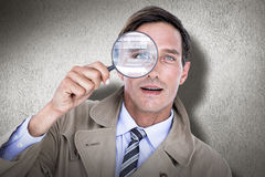Composite image of spy looking through magnifier Royalty Free Stock Photos