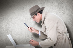 Composite image of spy looking through magnifier Royalty Free Stock Image