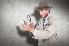 Composite image of spy looking through magnifier Stock Image