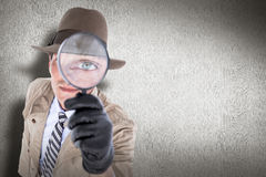 Composite image of spy looking through magnifier Stock Images