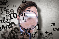 Composite image of spy looking through magnifier Stock Photos