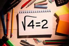 Composite image of square root of four on notepad Stock Images