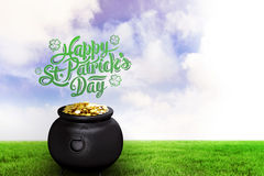 Composite image of st patricks day greeting. St patricks day greeting against green field Stock Image