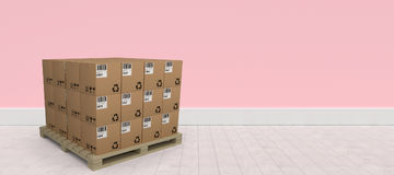 Composite image of stack of brown cardboard boxes arranged on wooden pallet. Stack of brown cardboard boxes arranged on wooden pallet against pink wall by Royalty Free Stock Photos