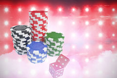 Composite image of stack of colorful casino tokens by dice Stock Photo