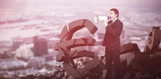 Composite image of standing businessman shouting through a megaphone Royalty Free Stock Images