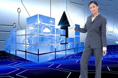 Composite image of standing businesswoman presenting Stock Photography