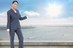 Composite image of standing businesswoman presenting Royalty Free Stock Images