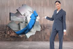Composite image of standing businesswoman presenting Stock Photos