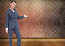 Composite image of standing businesswoman presenting Stock Image